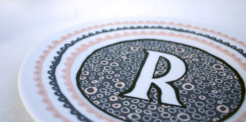 Handpainted monogram R upcycled plate. © Julie Terwelp/SnapHappy Creative