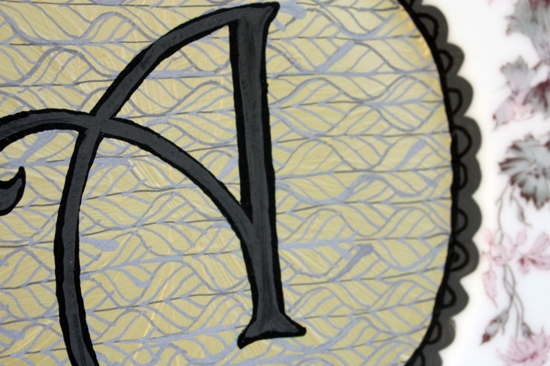 Closeup of handpainted monogram A plate. © Julie Terwelp/SnapHappy Creative